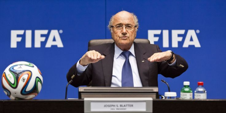 FIFA president Sepp Blatter talks during a press conference following an executive meeting of the football's world governing body at the Home of FIFA on March 21, 2014 in Zurich. A report on migrant workers' rights in Qatar ahead of the 2022 World Cup and the 2014 FIFA World Cup in Brazil was on the agenda. AFP PHOTO / MICHAEL BUHOLZER        (Photo credit should read MICHAEL BUHOLZER/AFP/Getty Images)